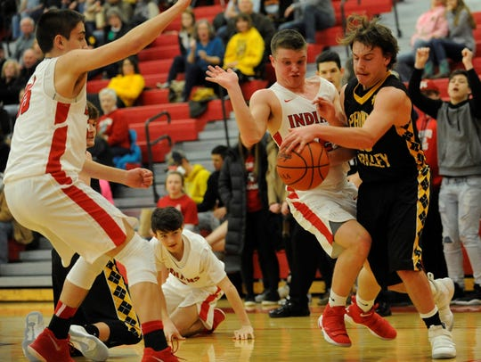 Paint Valley's Caden Grubb attempts to save a loose