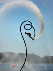 World champ Suksan Tongthai performs a routine featuring triple aerial backflips. Sugden Regional Park in East Naples hosted the Flyboard World Cup Championships over the weekend, with contestants soaring nearly 50 feet into the air powered by jets of water.