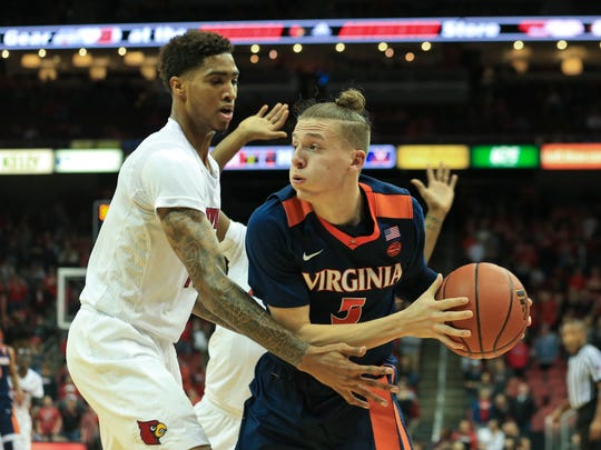 Virginia's Kyle Guy looks to pass as he's pressured