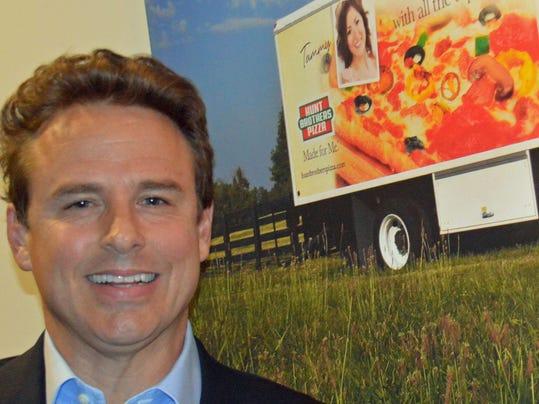 Britt Hunt - with truck photo.jpg