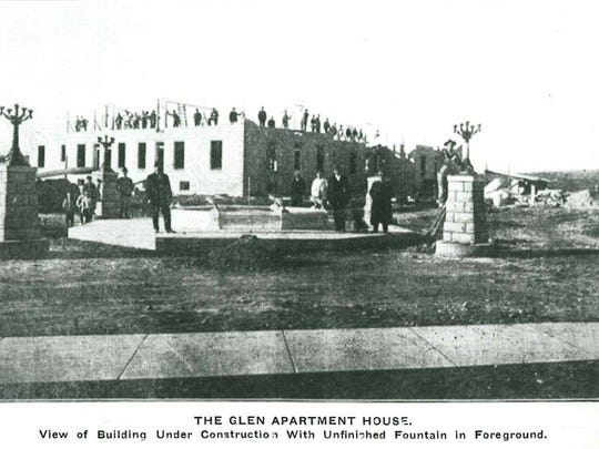 The Glen Apartment House while it was under construction. The under-construction fountain is in the foreground.