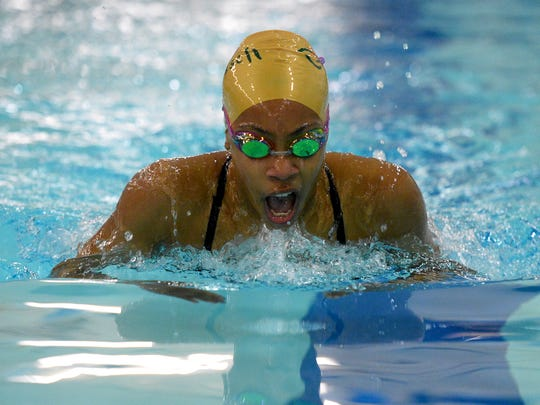 CMR's Ayana Gray competes in the 200-yard IM during the crosstown swim meet in 2017.