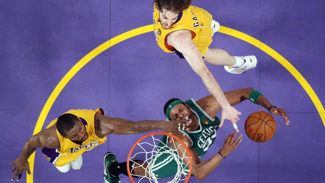 Boston Celtics forward Paul Pierce, lower right, has his shot blocked by Los Angeles Lakers forward Ron Artest, left, and forward Pau Gasol of Spain during the second half in Game 7 of the NBA Finals, Thursday, June 17, 2010, in Los Angeles. The Lakers won 83-79.