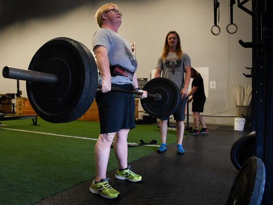 Special olympian Eric Wilson works on his deadlift
