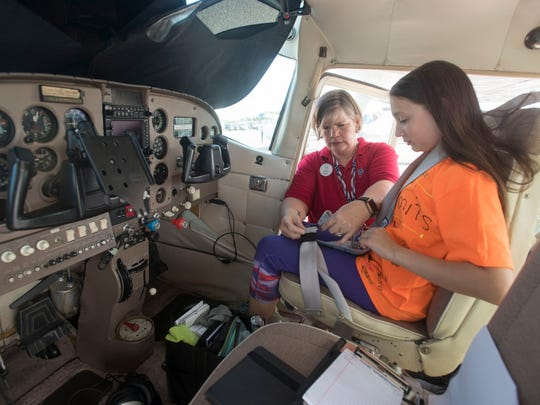 Madison Smith gets ready to take to the sky with pilot