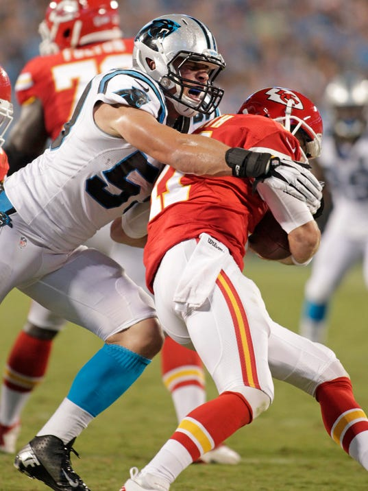 Kansas City Chiefs' Alex Smith (11) is sacked by Carolina Panthers' Luke Kuechly (59) during the first half of an NFL preseason football game in Charlotte, N.C., Sunday, Aug. 17, 2014. (AP Photo/Bob Leverone)