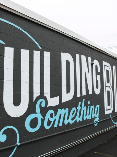 "The ""Building Someting Bigger than Ourselves, Together"" mural in the Shelby Park neighborhood on the side of The Park building. Feb. 15, 2016"