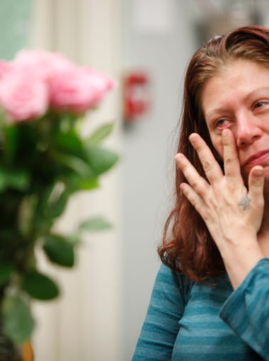 Kymball Pruett wipes away a tear as she was honored with testimonials from fellow residents at the Volunteers of America's Freedom House. Pruett graduated form the progrram as was in the process of moving to an apartment. May 10, 2016.