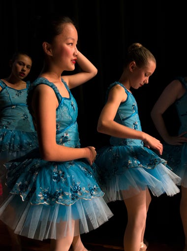 """A group of dancers waited to go on stage for a Ballet Arts Studio dress rehearsal at the Clifton Center. The school is closing after 47 years in business due to the """"repurposing"""" of the center by the Archdiocese of Louisville. In foreground is Mia Osbourne, age 14. May 18, 2017."""