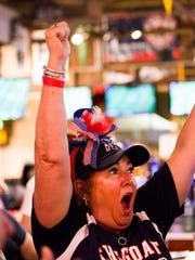Cheryl Wadas yells as the New England Patriots make a play during Super Bowl LII against the Philadelphia Eagles on Sunday, Feb. 4, 2018, at Foxboro Sports Tavern in East Naples.