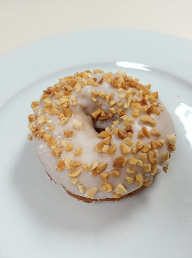 Blooming Donuts | The new, zany doughnut shops notwithstanding, most places serve a fairly standardized list of classics, and finding daylight between the contenders on the bubble can be tough. Blooming Donuts, however, is one that poked its head above the fray. The glaze is light and tender with a hint of oil flavor (I don't mind when it's good), and the cake is well-developed with a nice crisp edge. I tried a buttermilk bar with a gentle sourness and perfect balance; an old-fashioned that was right on point; and a chocolate cake that stopped shy of being overly sweet. But my favorite was a vanilla glazed cake doughnut with a killer crisp on the bottom and a thick layer of crunchy toasted peanuts on top. | DETAILS: 9820 W. Lower Buckeye Road, Tolleson. 623-936-7488, facebook.com/bloomingdonutstolleson.