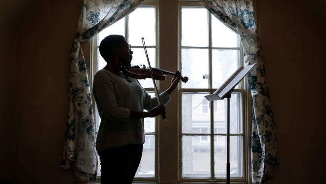 Cordia Pickerill practices upstairs at the West Louisville Talent Education Center. Pickerill begain taking lessons with Keith Cook at the center when she was in eighth grade. Today, soe is a UofL graduate and music teacher and helps Cook's students in her free time. Feb. 11, 2017
