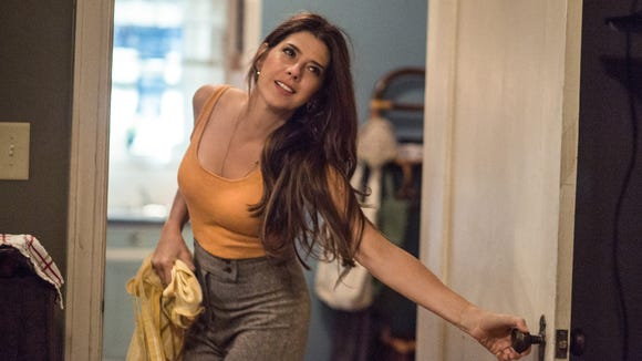 Aunt May (Marisa Tomei) learns a big secret at the