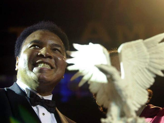 Boxing legend Muhammad Ali smiles after receiving the highest honor presented by the National Association of Broadcasters Education Foundation, Monday, June 11, 2001 for his lifelong commitment to world peace, tolerance and human rights, and for his ongoing efforts to establish the Muhammad Ali Center in his hometown of Louisville, Ky.