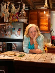 Martha Toomey pauses before preparing lunch at home