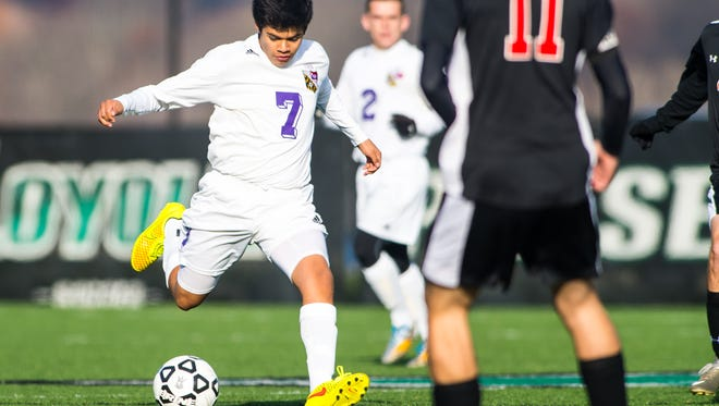 Crisfield defender Eduardo Zetina (7) passes up field against North Carroll on Saturday, November 21st at the Ridley Athletic Conference in the 1A MPSSAA finals.