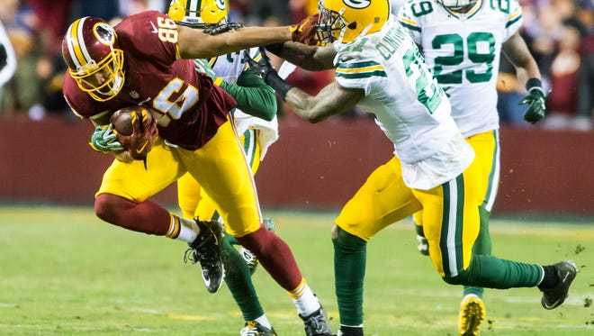 Washington tight end Jordan Reed (86) rumbles for a first down against Green Bay in the NFL Wild Card Playoff on Sunday, Jan. 10, at FedEx Field in Landover, Md.