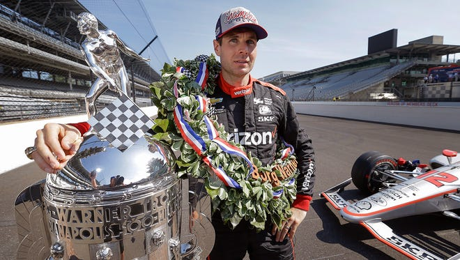 Winner of the102nd running of the Indianapolis 500 Will Power poses for photos with the Borg-Warner Trophy at Indianapolis Motor Speedway on Monday, May 28, 2018.