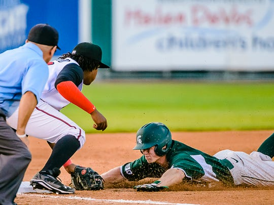 Danny Gleaves ,right, of MSU slides into a tag by Vladimir Guerrero of the Lugnuts in an attempt to reach 3rd base for the last out in the top of the 3rd inning.