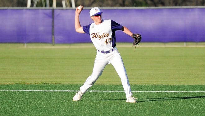 Wylie second baseman Balin Valentine (47) throws to first for an out during the Bulldogs' 10-4 win against Snyder at Bulldog Field on Tuesday, April 3, 2018.