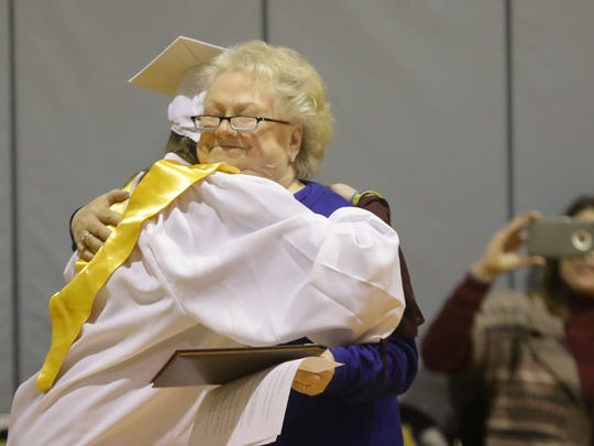 Head of Padua Academy Cindy Hayes-Mann gives 19 year-old Kelly Muschiatti a hug after giving her an official diploma from the school on Wednesday. Muschiatti survived the car accident that took the life of Salesianum student Tyler Brown in March of 2016. Her injuries kept her from getting an official degree until she healed.