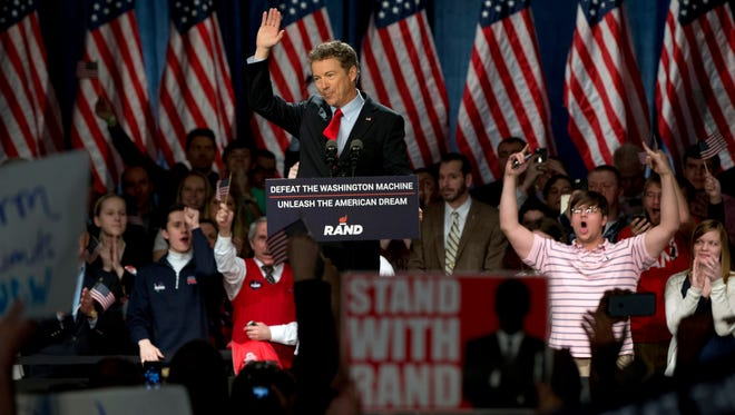 """Sen. Rand Paul, R-Ky., announces the start of his presidential campaign as the audience cheers, Tuesday, April 7, 2015, at the Galt House Hotel in Louisville, Ky. Paul launched his 2016 presidential campaign Tuesday with a combative message against both Washington and his fellow Republicans, declaring that """"we have come to take our country back."""" (AP Photo/Carolyn Kaster)"""