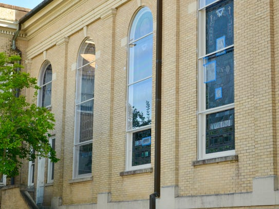 Pieces of the 93-year-old stained-glass windows at First United Methodist Church in Lafayette were repaired as new Lexan plexiglass was fitted over the exterior for protection.