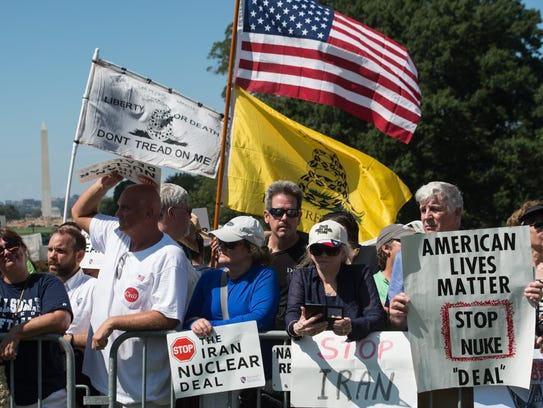 People attend a rally organized by the Tea Party Patriots