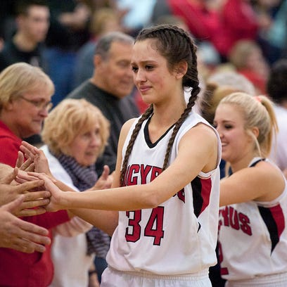 Hannah Gulley shakes the Bucyrus' fans hands after