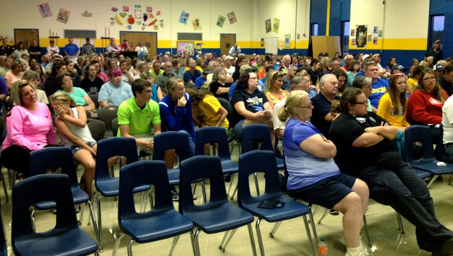 A large crowd filled the Union cafeteria for a meeting about the future of the school district.