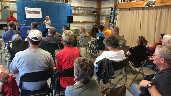 About 30 people gathered to talk about plans to close the intersection of Doaks Ferry Road NW and Hwy. 22 at a meeting June 11, 2014.
