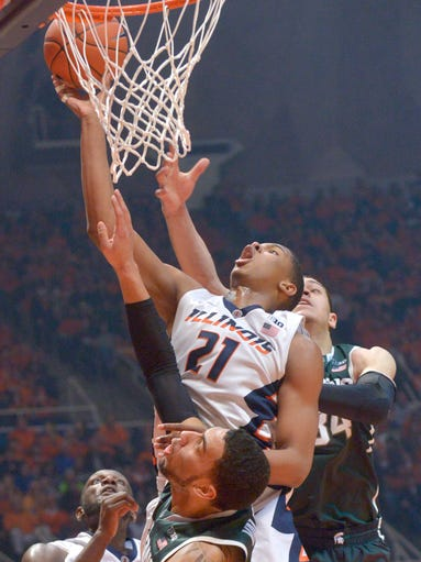Illinois guard Malcolm Hill shoots between Michigan