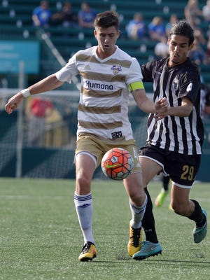 Aodhan Quinn fights for the ball against the Rochester Rhinos, June 18, 2016