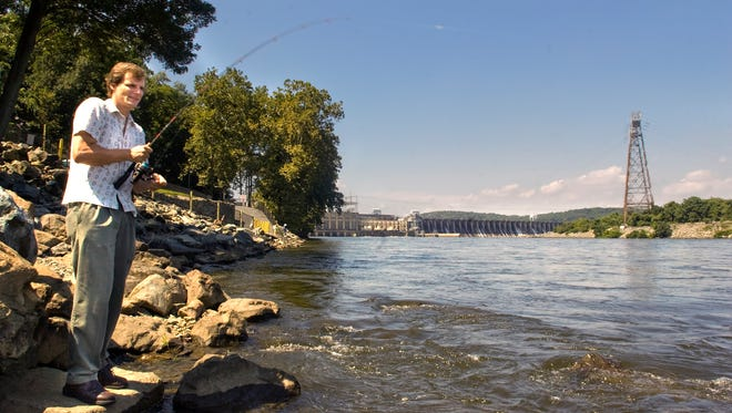 Since buying a home on the banks of the Codorus Creek, Helfrich has been fishing more, including trying his hand below the Conowingo  Dam in Maryland. Photo taken in August 2009.