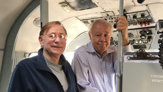 Jim Meinert, left, and Craig Wirth stand in the cockpit of a C-54 before the Berlin Airlift reunion in September 2016. Their fifth documentary will be on the legacy of the military in northcentral Montana.