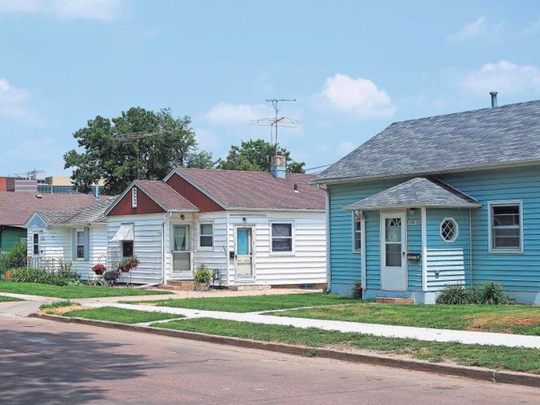 Homes along 8th Avenue between 24th and 26th Streets on Friday in Sioux Falls. Sioux Falls Surgical Physicians sold 69 houses to Avera on Thursday. They are located in the area between 23rd and 26th streets and Seventh and Cliff avenues.