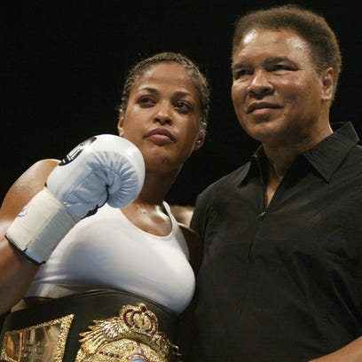 Boxer Laila Ali poses with her father, former heavyweight