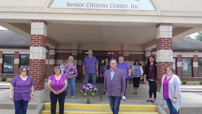 Guernsey County Senior Citizens Center Inc. employees wore purple on June 15 in recognition of Worldwide Elder Abuse Awareness Day. Pictured are, l to r, front row, Valerie Wray, administrative assistant; Susan Stuebe, care navigator; Shon Gress, executive director & CEO; Catherine Carpenter, Home Delivered Meals assessor; second row, Shirley Carna, Nutrition Department administrative assistant; Garland Harper, Maintenance Department manager; Scott Lashley, maintenance associate; Amy Brown, Social Services coordinator; third row, Janie Downerd, activities coordinator; Alice Hayes, Home Health Department manager; and Rhonda Foraker, executive assistant.