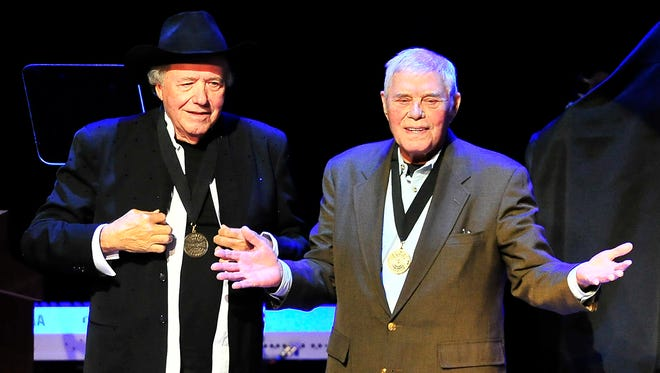 Bobby Bare, left, receives a medal from Tom T. Hall during the Medallion Ceremony at Country Music Hall of Fame in Nashville on Oct. 27.