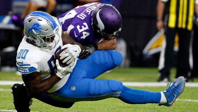 Lions tight end Michael Roberts catches a pass in front of Vikings safety Andrew Sendejo in the second half Sunday, Oct. 1, 2017 in Minneapolis.