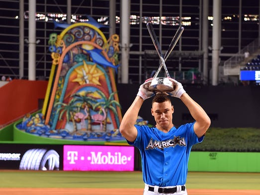 Aaron Judge hoists the trophy after winning the Home