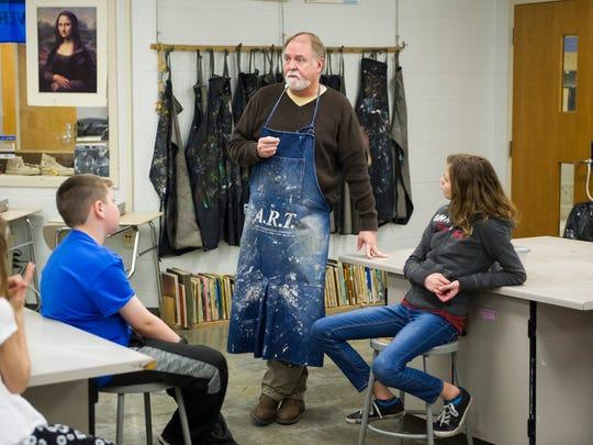 John Gentry of Darmstadt, speaks to his visual arts
