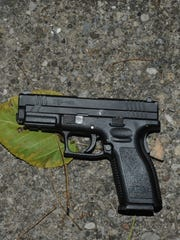 A gun that one of the suspects threw out of the apartment
