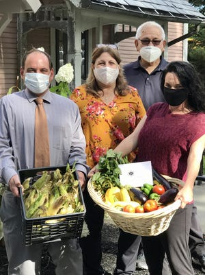 With donated produce at the Clinton Senior Center are (from left) Mark Laverdure, outreach program resource coordinator; Debra Goodsell, director; Joe D'Ambra, Worcester County Sheriff's Office; and Stephanie Cerutti, meal site manager.