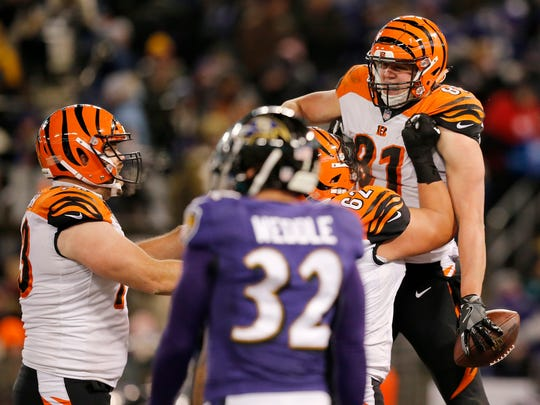 Cincinnati Bengals tight end Tyler Kroft (81) celebrates his second touchdown catch of the night in the second quarter of the NFL Week 17 game between the Baltimore Ravens and the Cincinnati Bengals at M&T Bank Stadium in Baltimore on Sunday, Dec. 31, 2017. At halftime the Bengals led 17-10.