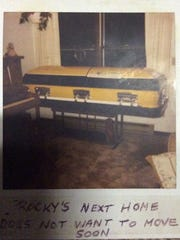 """When Dr. Robert """"Rocky"""" Rockstroh of Green Bay died at age 69 in 2003, he was buried in the green and gold coffin he had kept in his living room for the previous five years."""