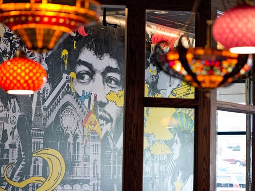 Take a look inside Mellow Mushroom's new pizzeria location in Oakley's Hyde Park Plaza. The face of Jimi Hendrix looms over Music Hall in a mural that decorates a side dining room.