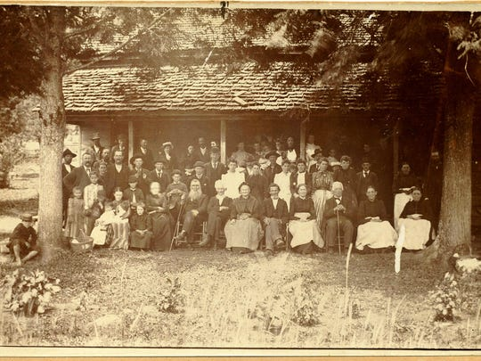 An undated photo shows the Siler clan gathering at the cabin built by  The cabin was built by Albert Siler, a great grandson of Plikard, in the 1880s. The cabin was later the birthplace of Lucy Morgan, the founder of the Penland School of Crafts.