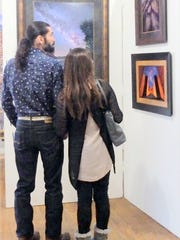 Two guests view some of the winning images.