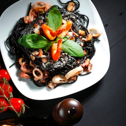 Goth food or foods like black spaghetti are expected
